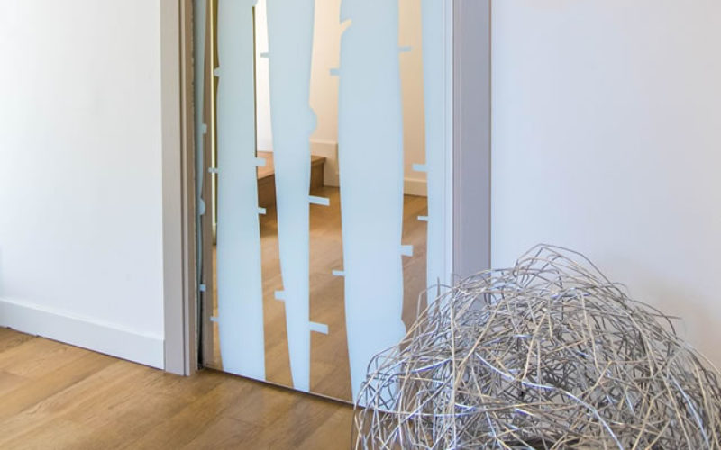 Advantages Of Elegant Glass Sliding Wardrobe Doors