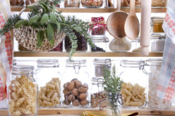 Small Decorative Pantry Shelving Containing What's Necessary to Cook