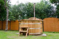 Rustic Wooden Water Hot Tub Tucked in Backyard