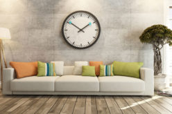 Modern Sofa Underneath Big Wall Clock