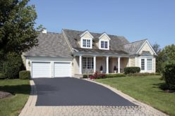 Home With a Partial Brick and Asphalt Driveway