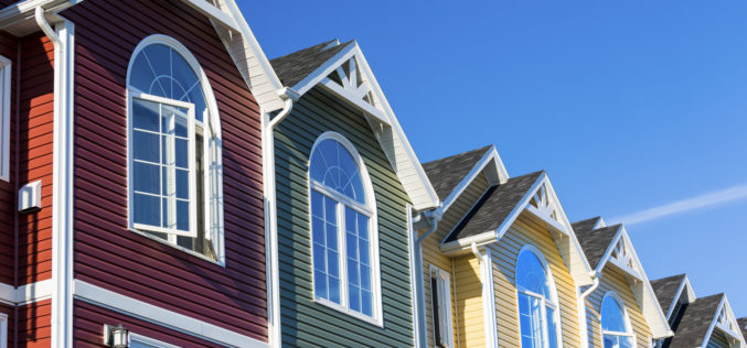 Row of Colorful Townhouses with Varied Colored Vinyl Siding