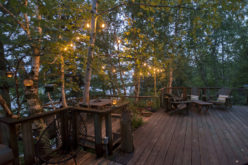 Wooden Deck Near Lake with Lighted Features