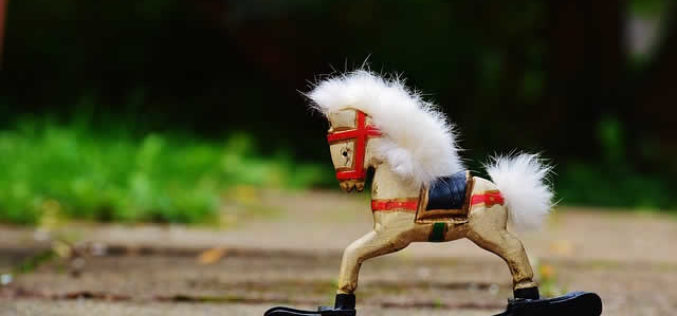 Riding a Vintage Rocking Horse